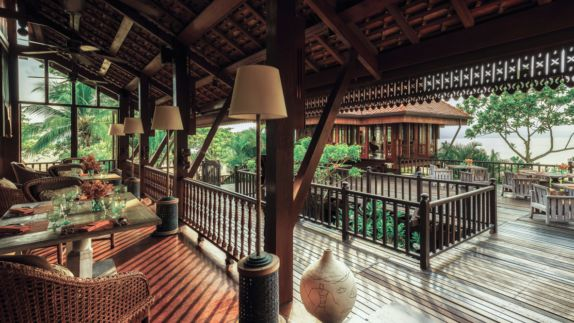 hotels in heaven four seasons langkawi restaurant culinary armchairs tables dishes lamps wooden floor vase
