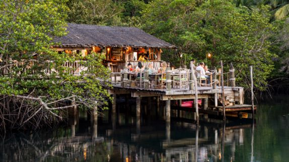 hotels in heaven soneva kiri culinary floating restaurant nature outside outdoors roof lights food water trees
