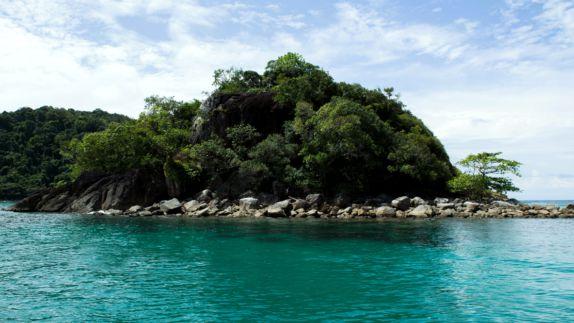 hotels in heaven soneva kiri outdoor location islands stones trees bushes sky cloudy palm trees ocean water