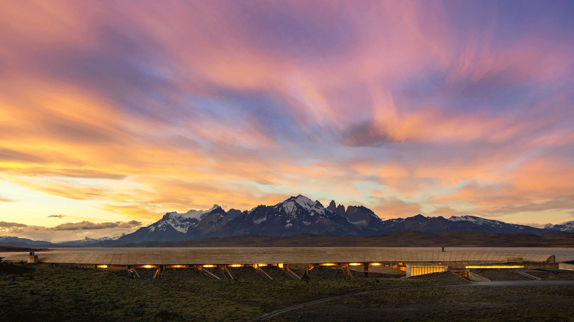 hotels in heaven tierra patagonia view location accommodation front colorful sky sunset mountains snow lights