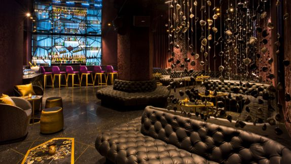 hotels in heaven w bogota bar culinary luxury beautiful decoration bar pillow seats couch coffee table bottles sparkling wine champagne noble