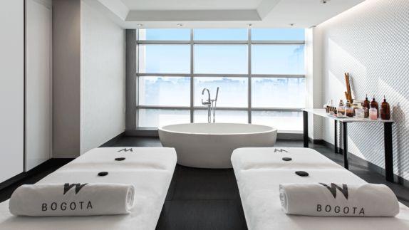 hotels in heaven w bogota spa welness relax luxury white massage oil massage table bath tub view noble