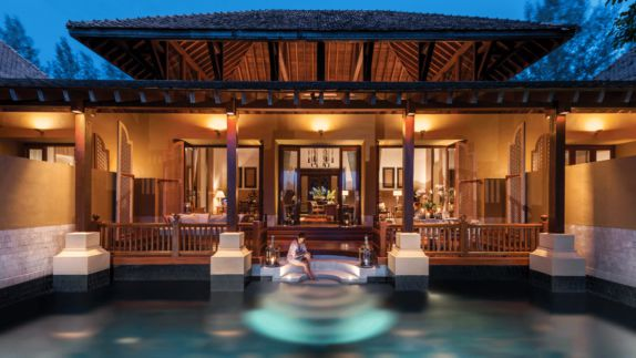 hotels in heaven four seasons langkawi pool outdoor woman relaxing water nighttime lights house terrace