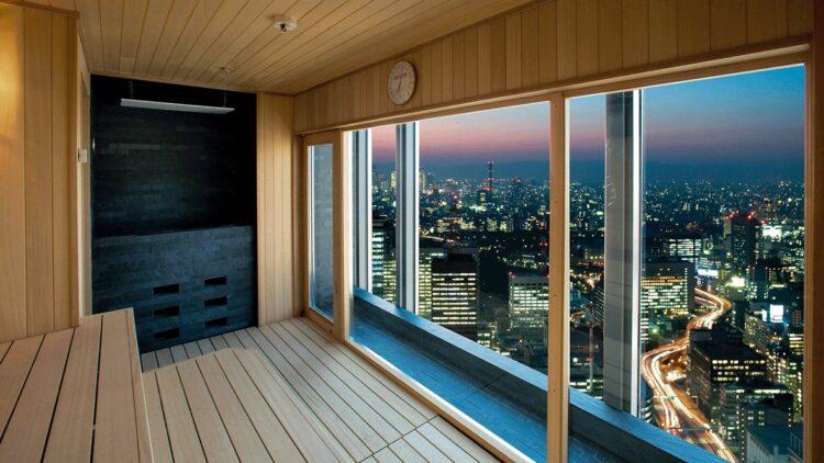hotels in heaven mandarin oriental tokyo spa dry sauna black wood wooden walls skyline view skyscrapers streets