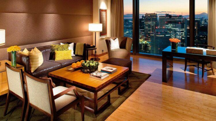 hotels in heaven mandarin oriental tokyo suite mandarin suite living room leather sofa armchairs books skyline view