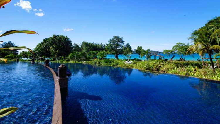 hotels in heaven raffles seychelles big pool view outdoor plants