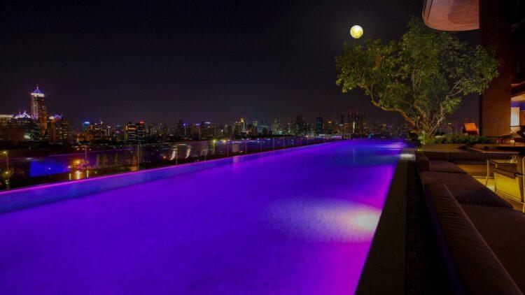 infinity pool night city view-sofitel bangkok