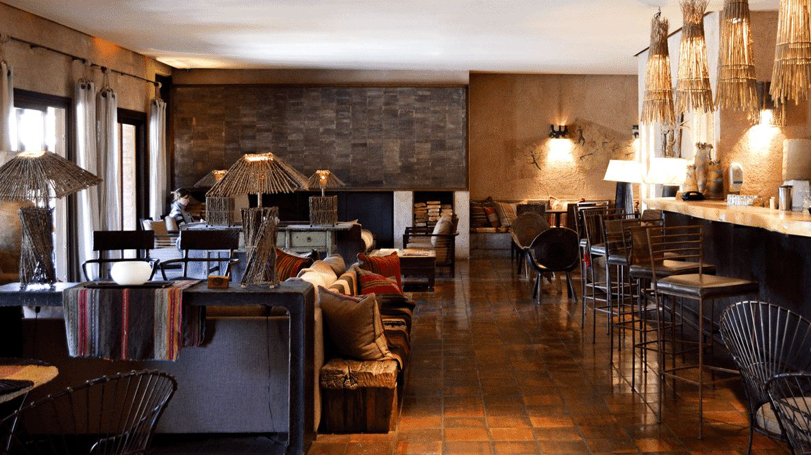 hotels in heaven alto atacama restaurant culinary wooden chairs lamps blankets shelves with books wooden floor
