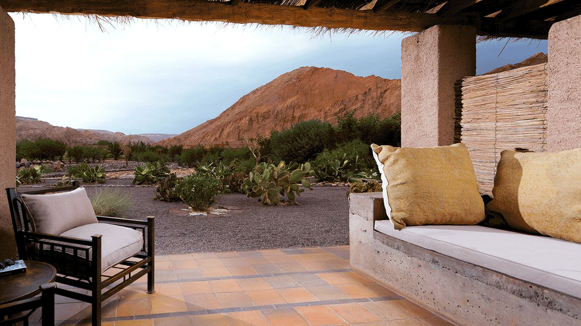 hotels in heaven alto atacama view location terrasse sofa white cushions mountains bushes cactus armchair pillows