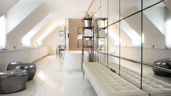hotels in heaven Royal Monceau Raffles Paris Penthouse Suite bathroom stones towels mirror wall grid shelves