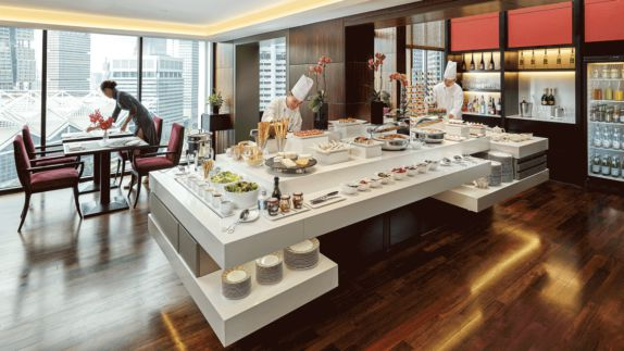 hotels in heaven oriental mandarin singapore culinary chef live cooking food dining room plates waitress skyline view