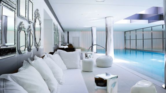 hotels in heaven royal monceau raffles paris pool spa mirrors water chic grid pillows sofa accommodation
