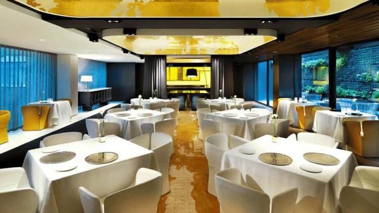 hotels in heaven mandarin oriental barcelona culinary restaurant tables table cloths plates flowers lights dining
