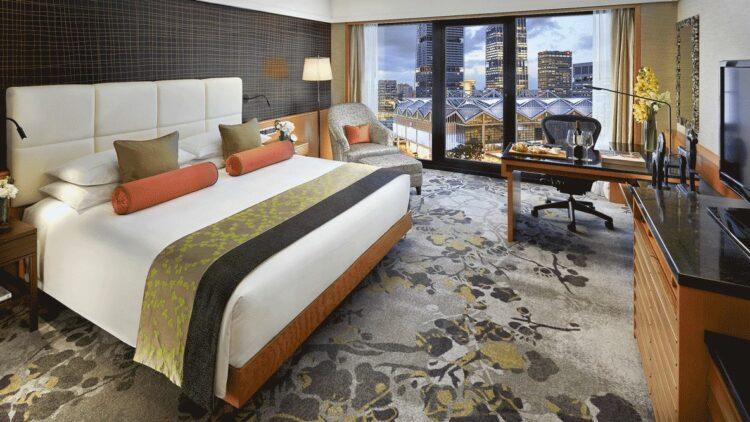 hotels in heaven mandarin oriental singapore bedroom view bed linen blanket skyline television rug colorful