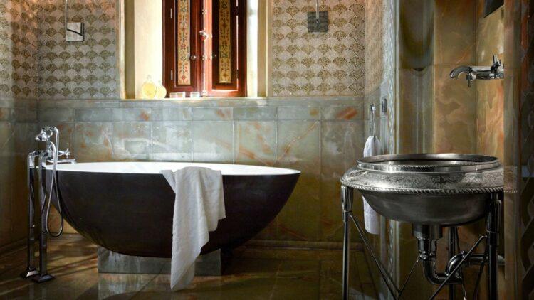 hotels in heaven royal mansour marrakech bathroom stone black bathtub silver sink and tab old art window
