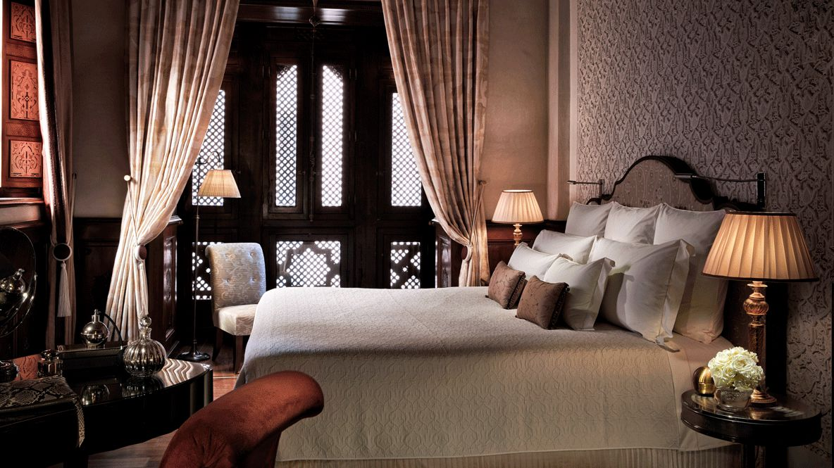hotels in heaven royal mansour marrakech bedroom luxury day blanket pillows lamps curtains cushioned armchair