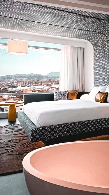 modern bedroom city view-w bogota colombia