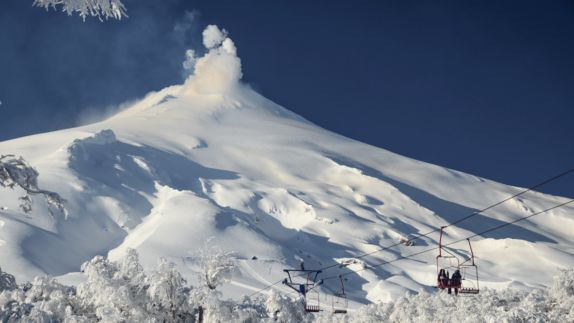 50 Skiing on Villarrica Volcano snow ski lift white blue sky tree people