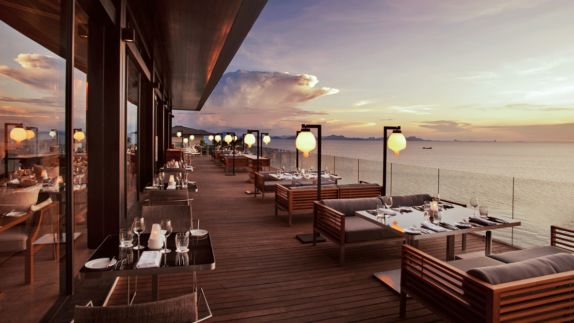 hotels in heaven culinary sunset outside luxury view clouds sunset lamp dinner wine glass dishes napkin plate chair table Thailand Koh Samui island