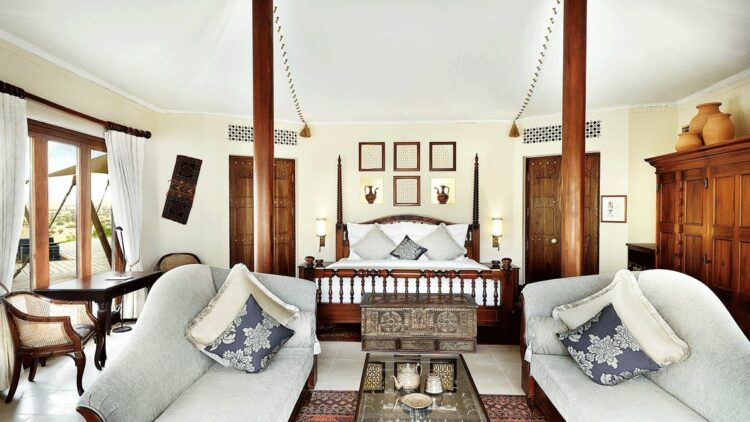 hotels in heaven al maha bedroom living room bed couch pill blanket door table chair vase curtains picture decoration inside