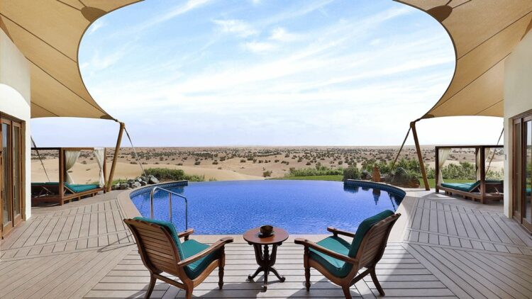hotels in heaven al maha private suite pool tent view chair ashtray deckchair stone sky door vase