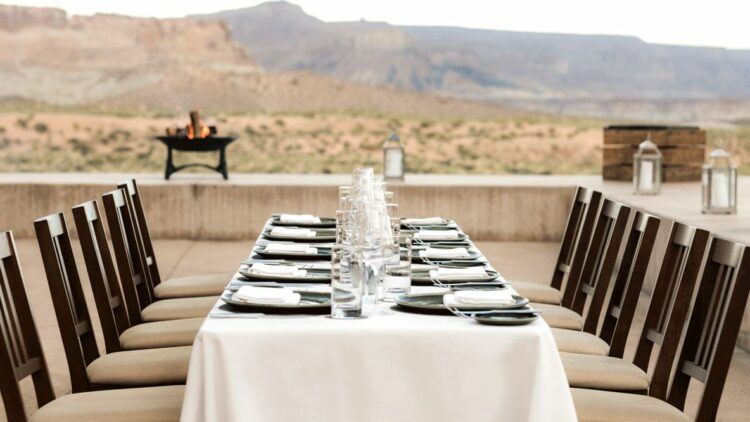 hotels in heaven amangiri utah culinary restaurant dining view dishes chair table tablecloth fire background nature glass hill napkins wine glass cutlery
