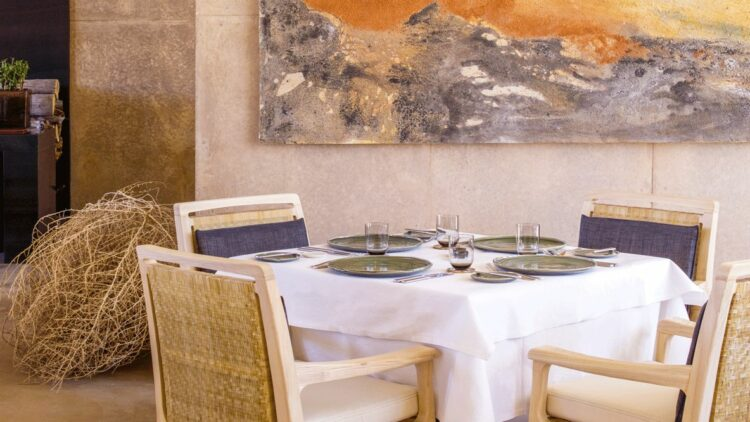 hotels in heaven amangiri utah dining culinary table chair dishes tablecloth decoration painting glass private dining room