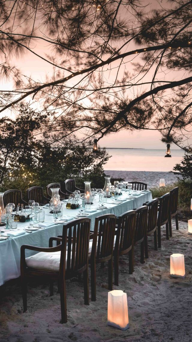 dinner table at the beach-andbeyond mnemba island tanzania