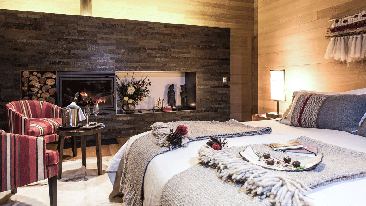 bedroom with fireplace-andbeyond vira vira chile