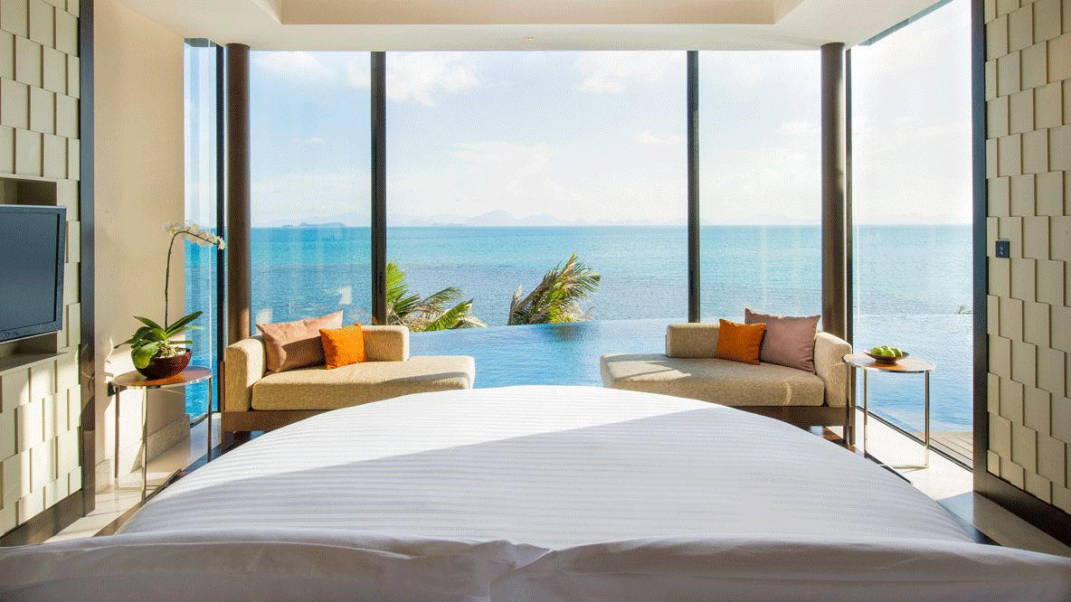 hotels in heaven accommodation bedroom view bed big windows dream room couch pillow sea sky clouds view tv stylish infinity pool palm tree plant design wall