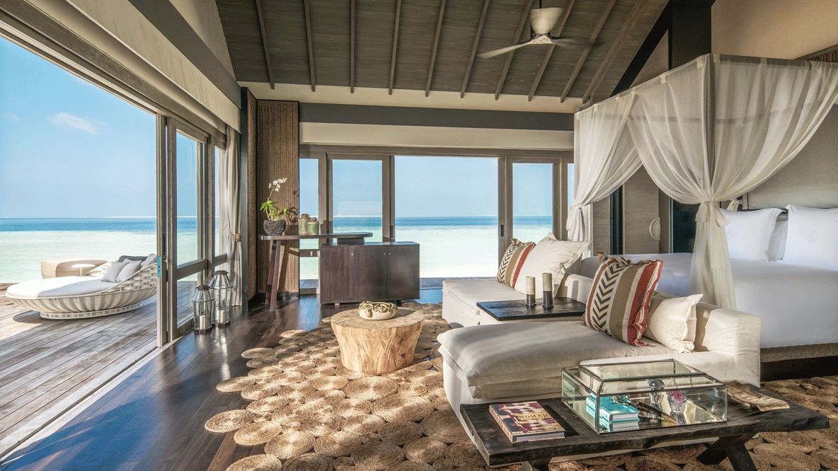 hotels in heaven four seasons private island voavah bungalow bedroom exclusive inside bed couch paradise luxury pillow lake furniture poster bed view sea sand plants book candle ventilator