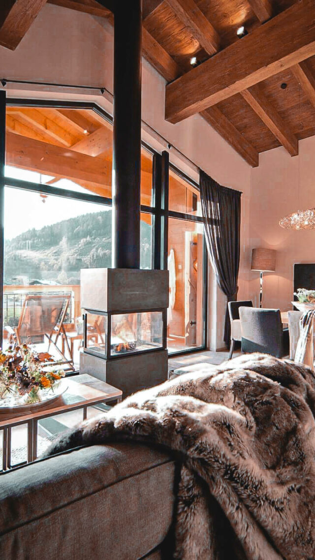livingroom with fireplace-hotel forsthofgut austria