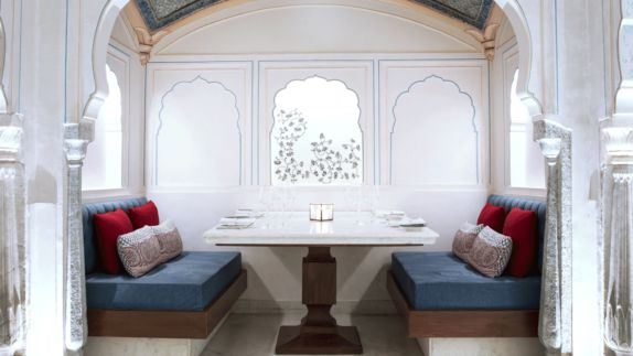 hotels in heaven Alila Fort Bishangarh culinary dining restaurant wine glass candle table banquette noble dinner beautiful dishes napkin