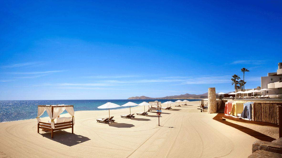 hotels in heaven LasVentanas al paraiso location beach sea deckchair sun sunny palm tree sand bungalow sign mountains luxury view way beautiful