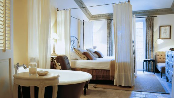 hotels in heaven accommodation bedroom luxury villa pillow bed bath tub lamp couch cupboard soap noble