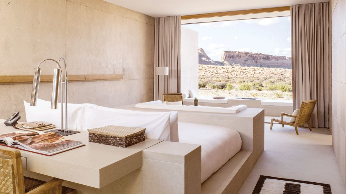 hotels in heaven amangiri utah bedroom private lodge room with a view desk book lamp phone bed chair nature chair plant curtains