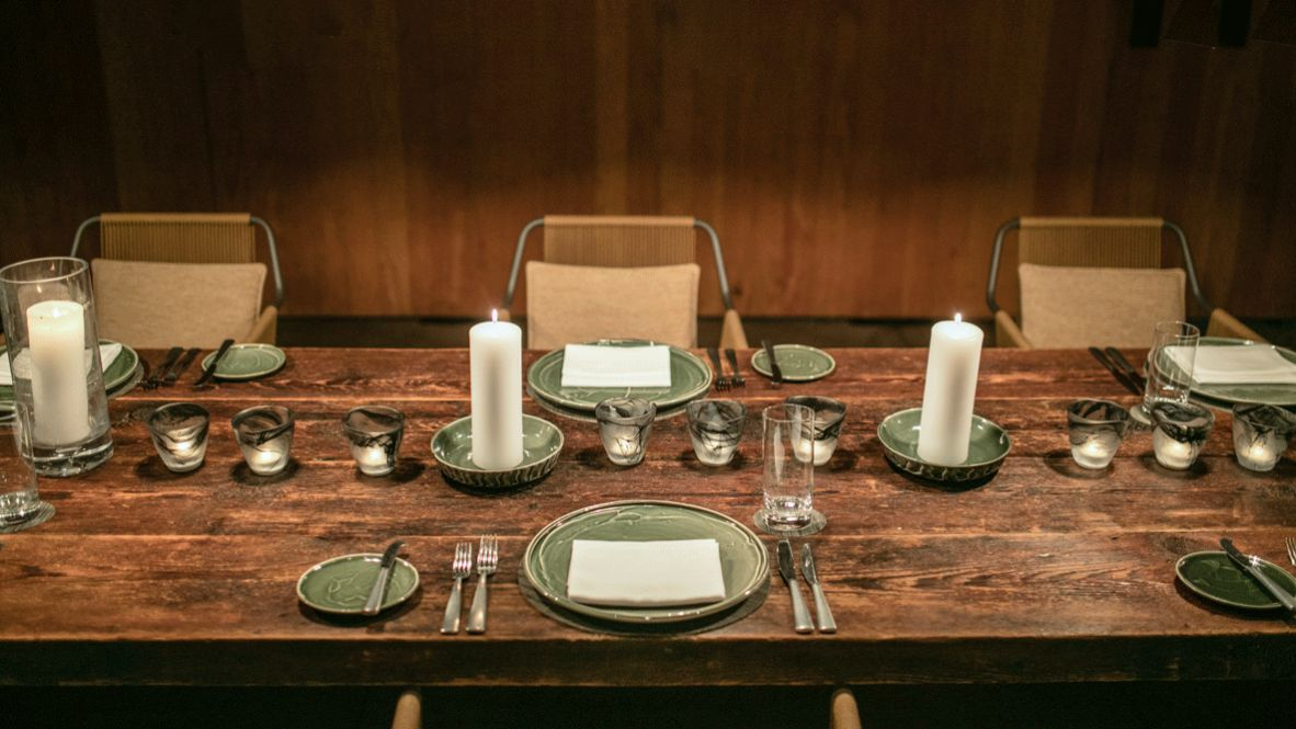 hotels in heaven amangiri utah dining table restaurant culinary dishes dinner candle chair napkin cutlery glass wood dinner room luxury