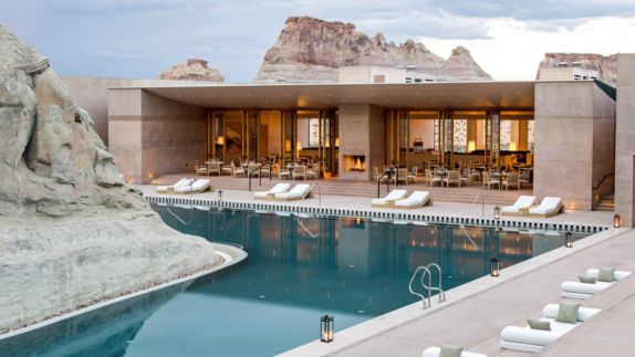 hotels in heaven amangiri utah pool luxury deckchair luxury hotel blue water stone fire lights romantic beautiful stair outdoor table chair