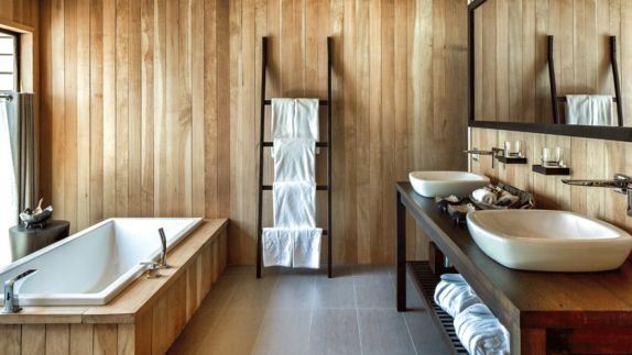 hotels in heaven and beyond vira vira accommodation bathroom tub towel washbasin glass step ladder wood curtain