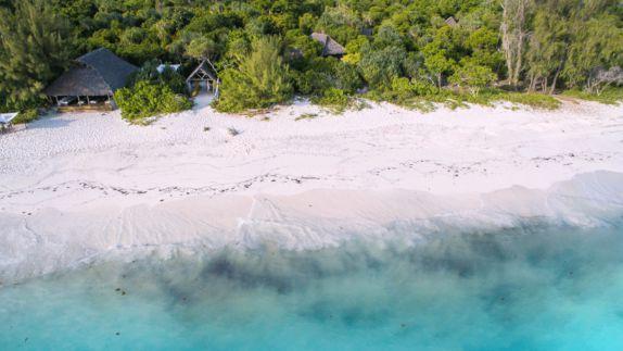 hotels in heaven andBeyond mnemba island lodge location island sea bungalow white sand plants beautiful beach