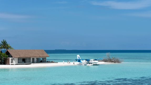 hotels in heaven four seasons private island voavah accommodation water plane lodge sea beach house airplane palm tree people nature paradise luxury