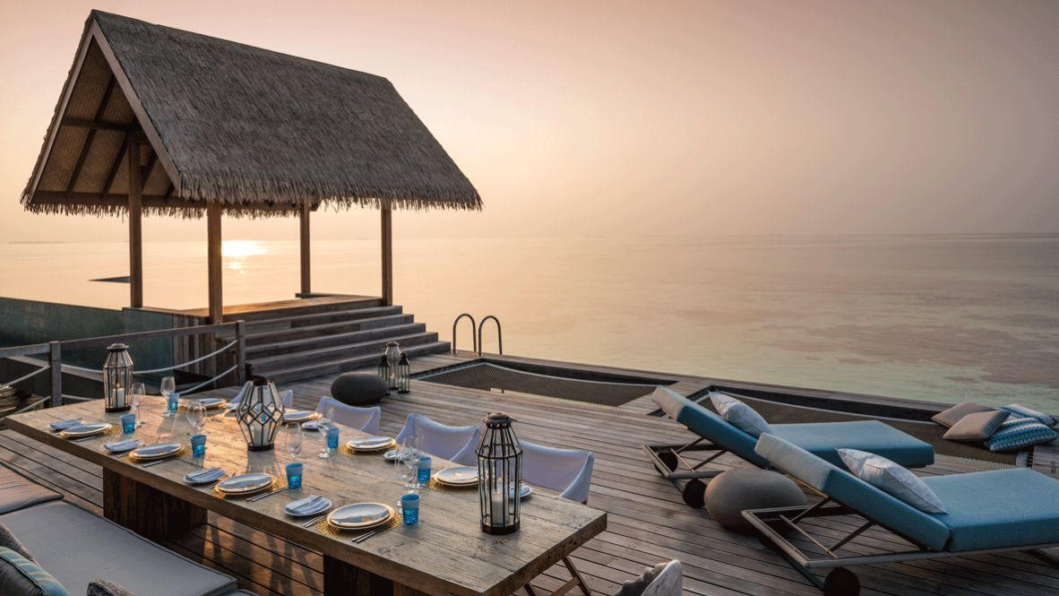 hotels in heaven four seasons private island voavah culinary ocean view wellness sunset dishes pool seats stairs candle table glass pillow wine glass napkin luxury