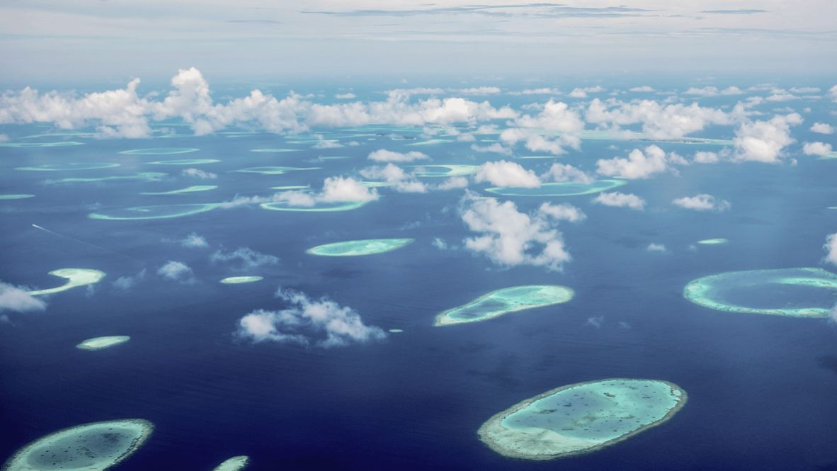 hotels in heaven four seasons private island voavah location beautiful blue sea clouds turquoise