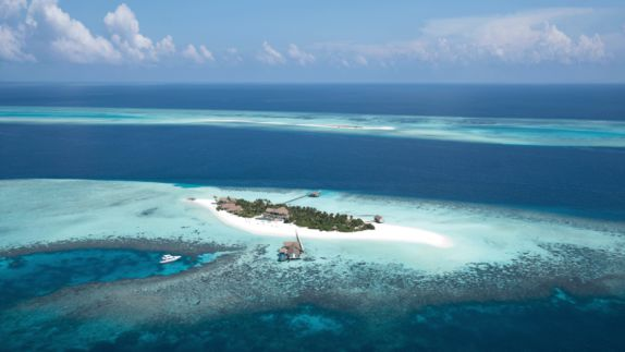 hotels in heaven four seasons private island voavah location accommodation dream sea white sand blue water houses tree boat luxury sky clouds