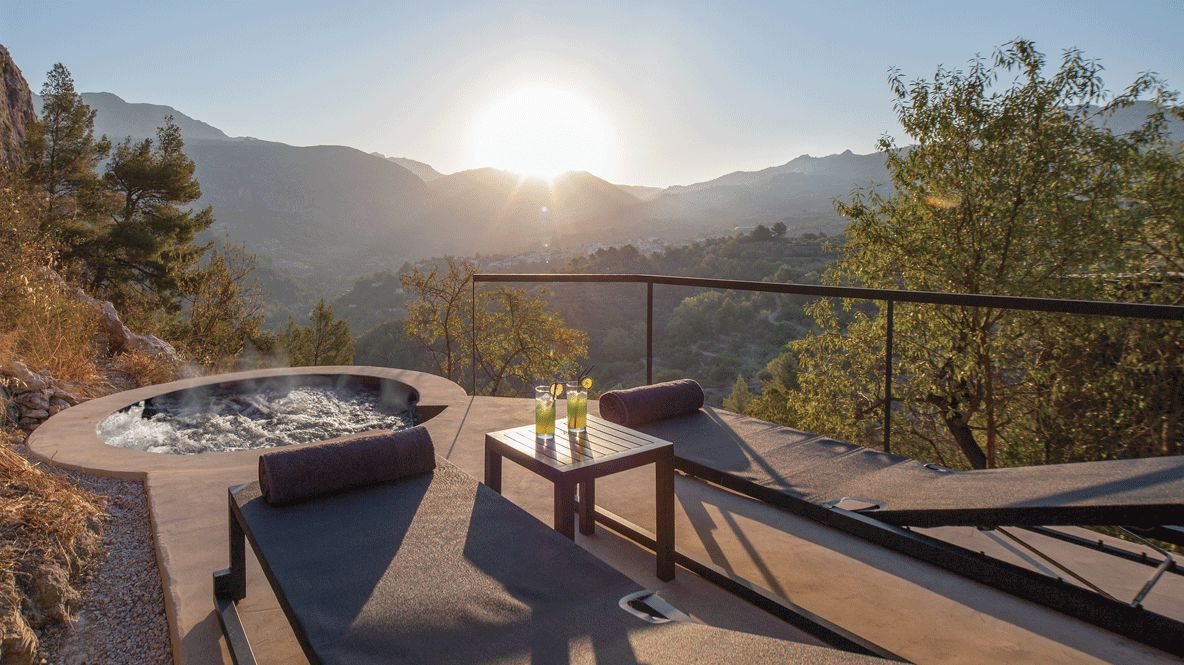 hotels in heaven guadalest vivood pool suite jacuzzi drinks hot view sunny sun infinity nature deckchair mountains table outside stones