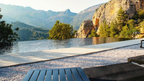 hotels in heaven guadalest vivood pool view luxury hotel infinity pool view mountains stones nature outside beautiful tree sunny sun