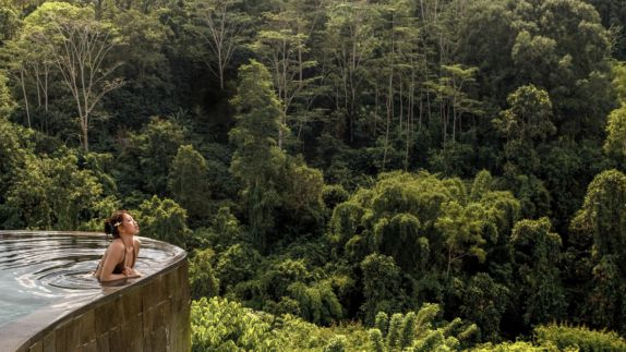 hotels in haven hanging gardens bali infinity pool location woman bikini jungle luxury jungle tree nature plants enjoying