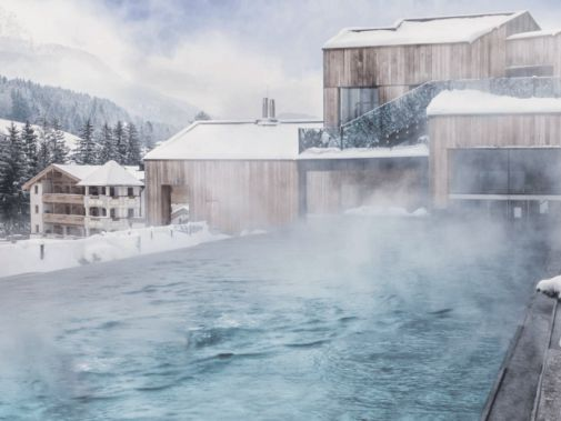 hotels in heaven hotel forsthofgut pool outdoor snow hot water mountain hill Austria luxury hotel location outside winter