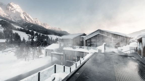 hotels in heaven hotel forsthofgut pool view infinity pool Austria luxury hotel snow white sun hot water beautiful winter tree location mountain