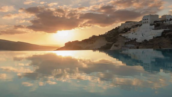 hotels in heaven katikies greece pool mirror view beautiful sunset clouds sea houses island hill mirrored beautiful